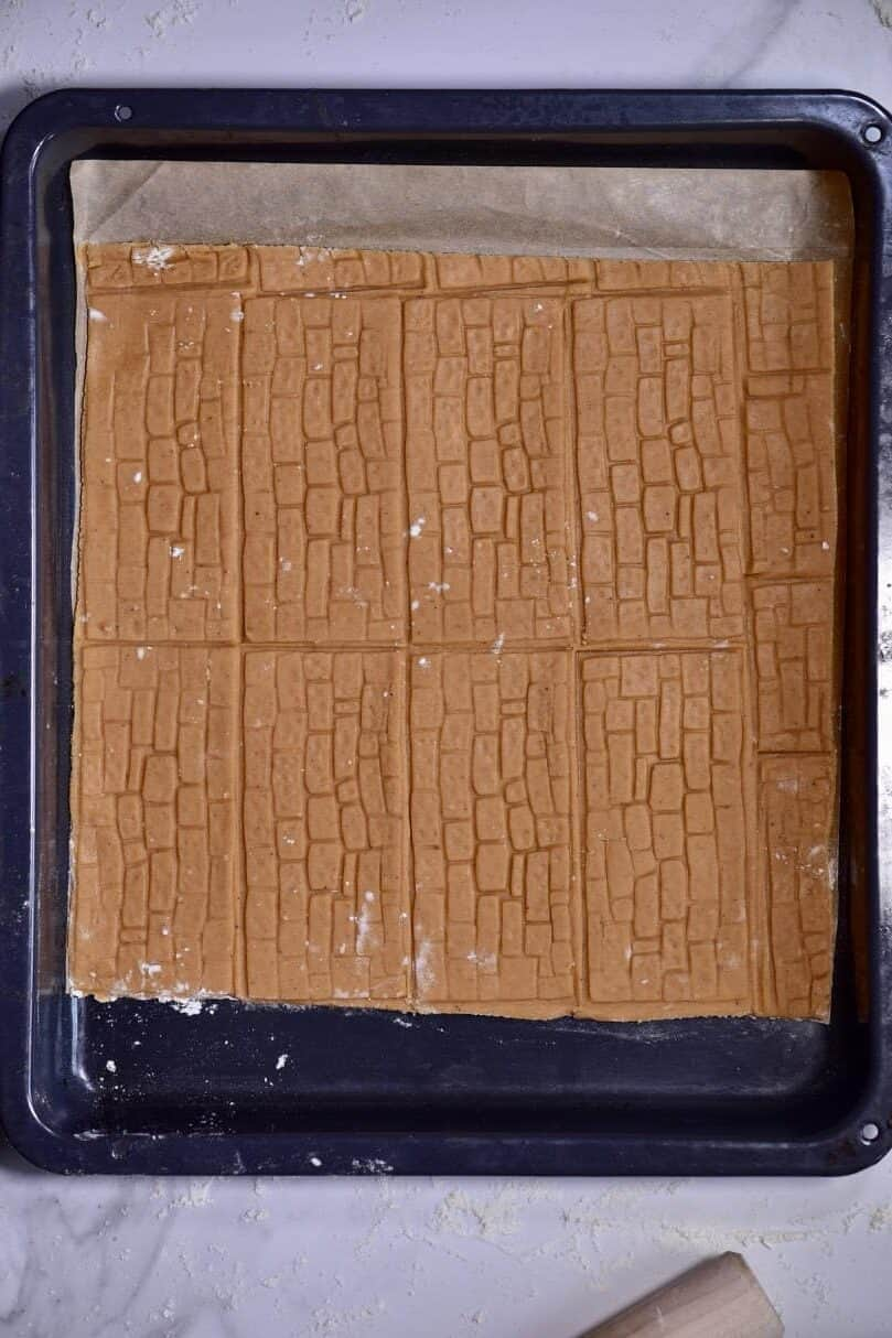 textured walls using a homemade gingerbread house template in a baking tray