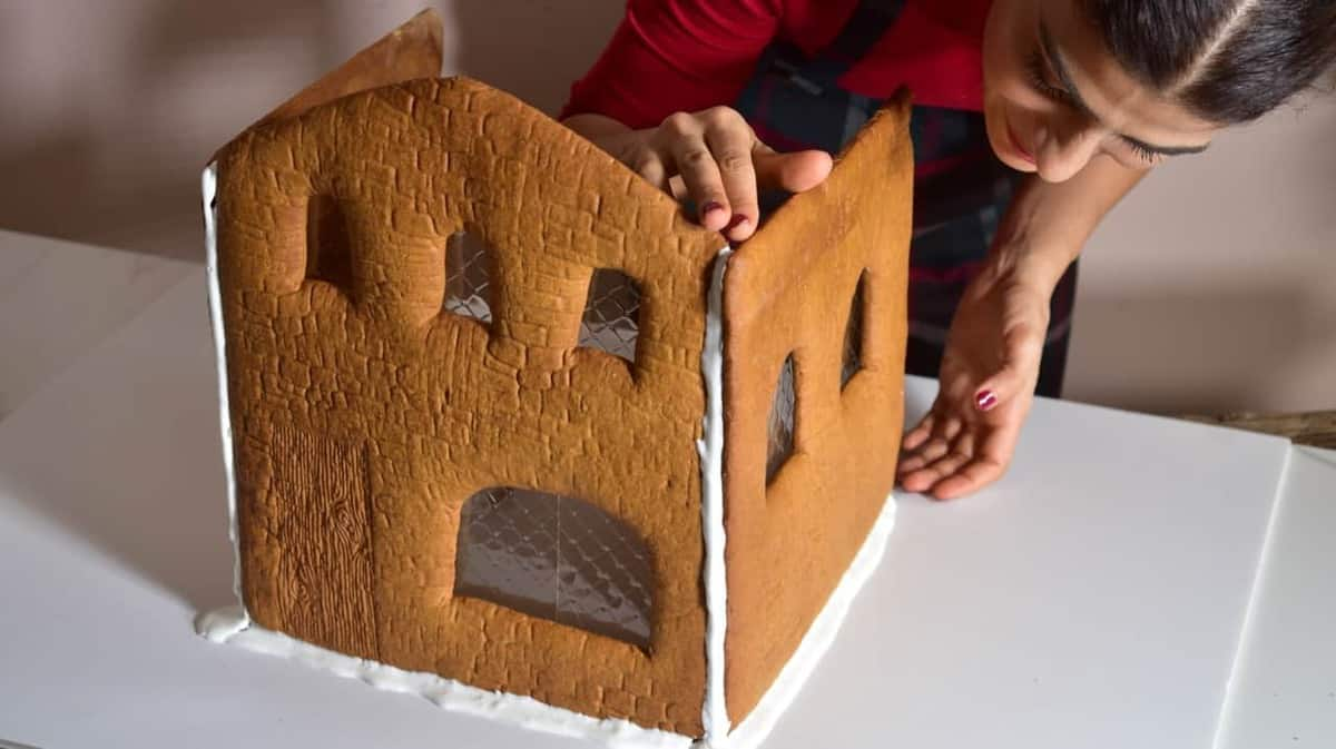 Securing a third wall on a gingerbread house