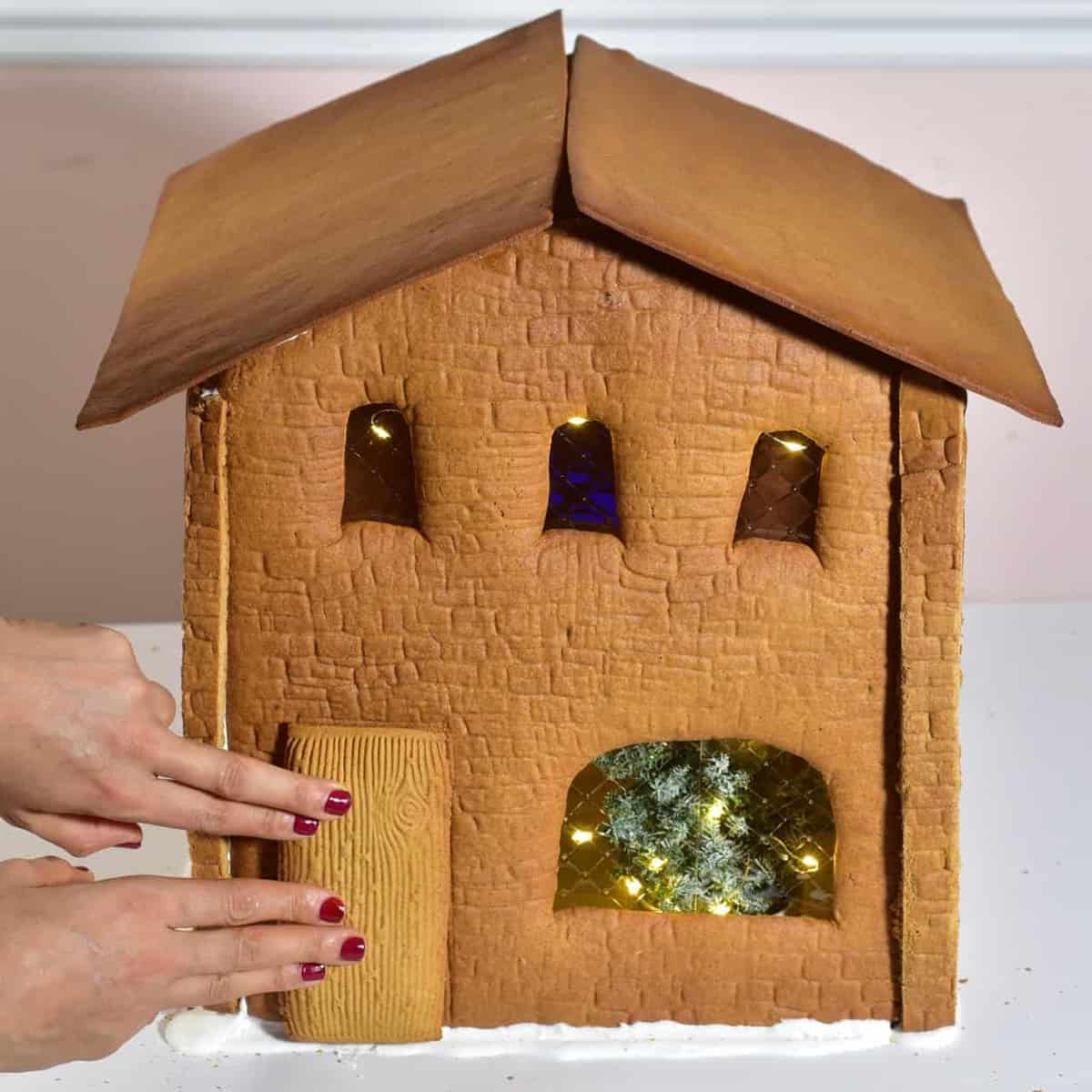adding the roof and door to a gingerbread house