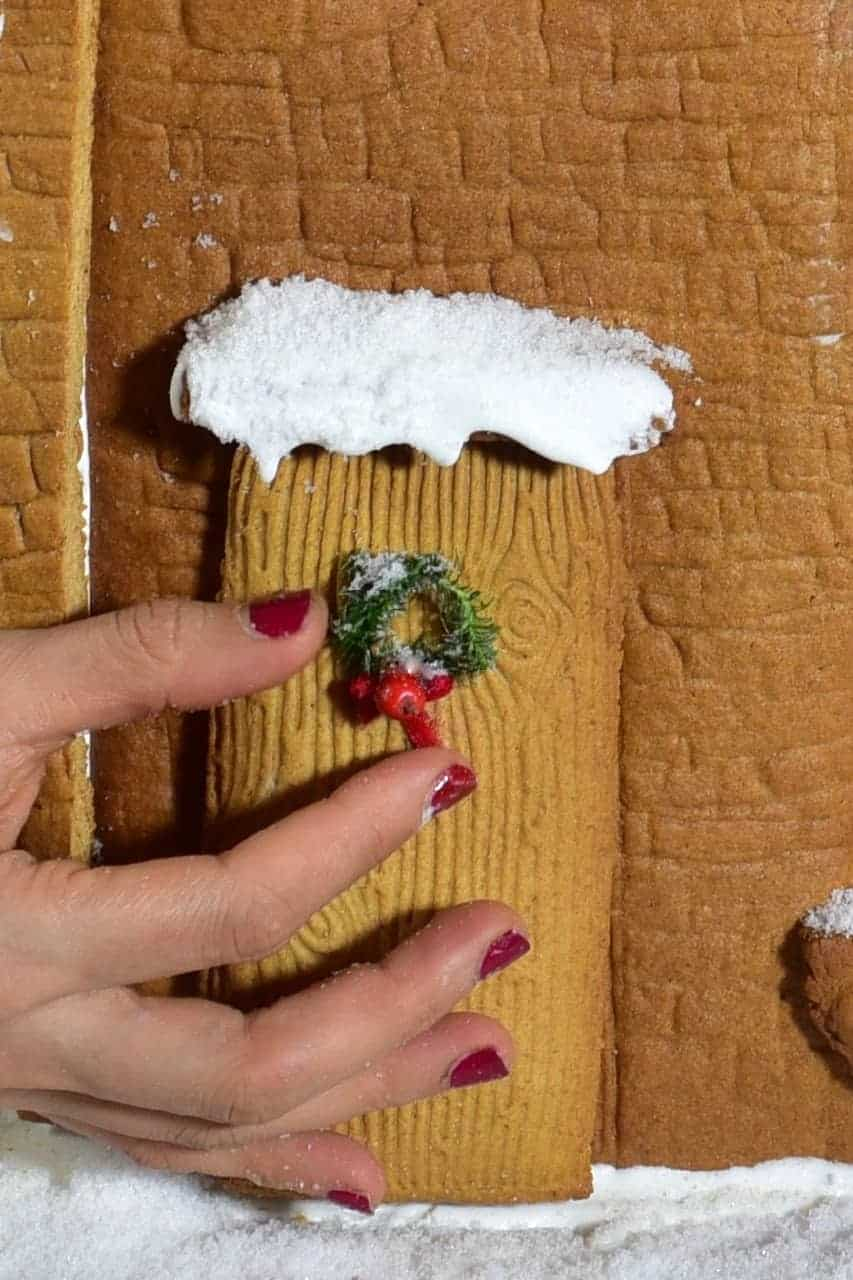 mini wreath on Christmas gingerbread house