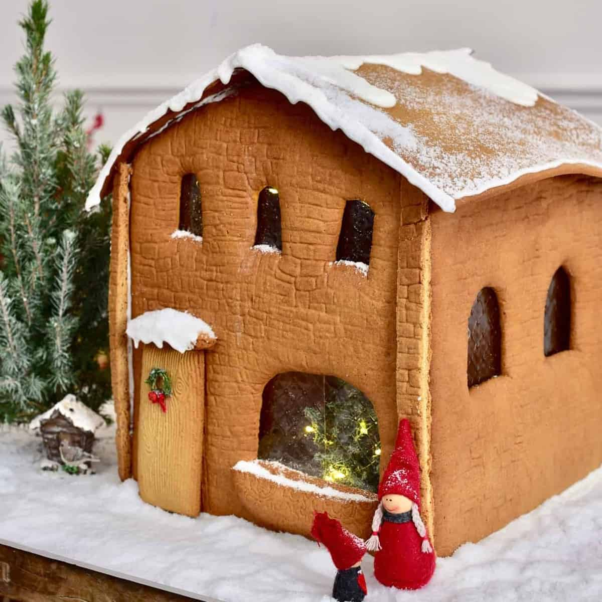 Side-view of gingerbread house with winter character