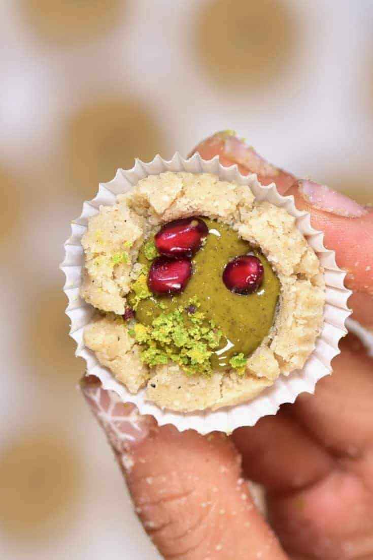 Delicious gluten-free, vegan bite-size almond & pistachio thumbprint cookies. Not only are they easy to make- they can either be baked or kept as a no-bake cookie recipe!