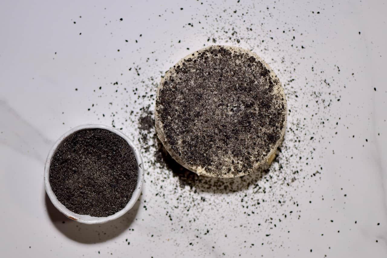 nigella seed and black peppercorn crusted vegan cheeze