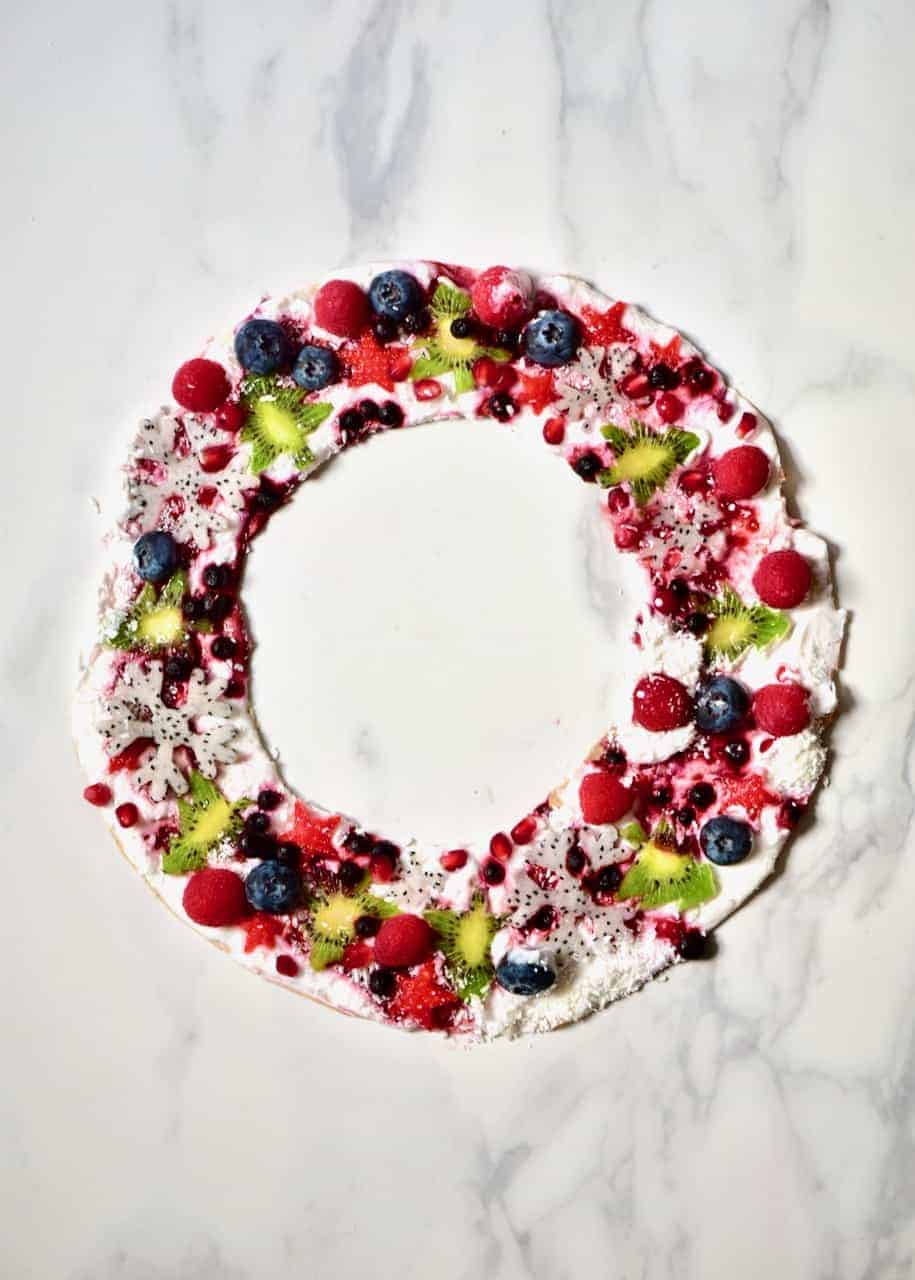 beautiful healthy Christmas snack - a vegan coconut yogurt frozen wreath