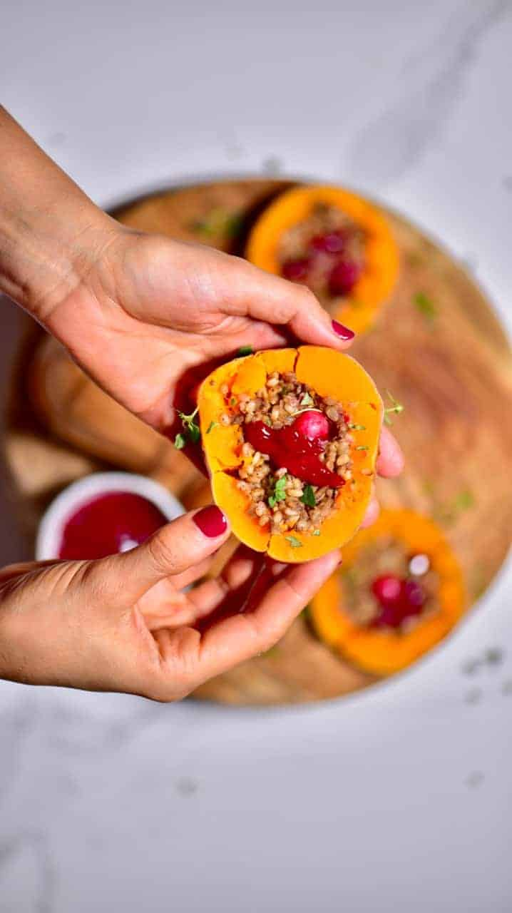 Delicious rice,mushroom & cranberry vegan stuffed butternut squash christmas recipe. A wonderful vegan roast alternative for a meat-free christmas. served with homemade cranberry sauce