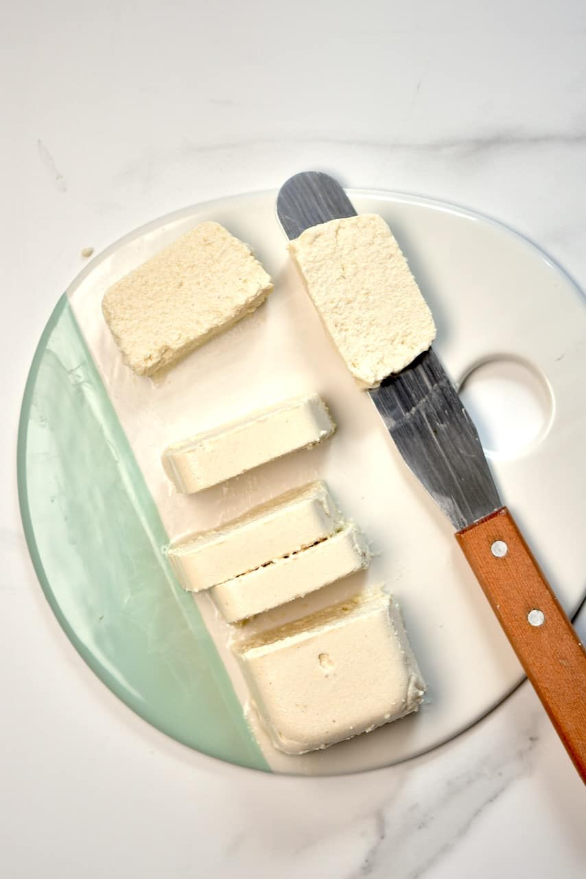 chopping vegan feta cheese