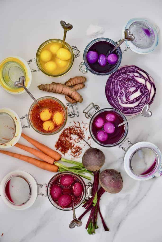 naturally dyed rainbow pickled quail eggs in their pickling liquid