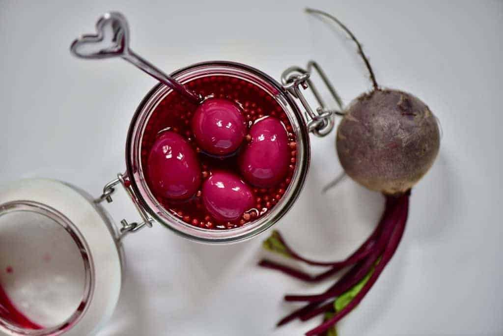 naturally dyed red pickled quail eggs