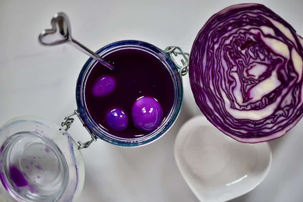 naturally dyed purple pickled quail eggs