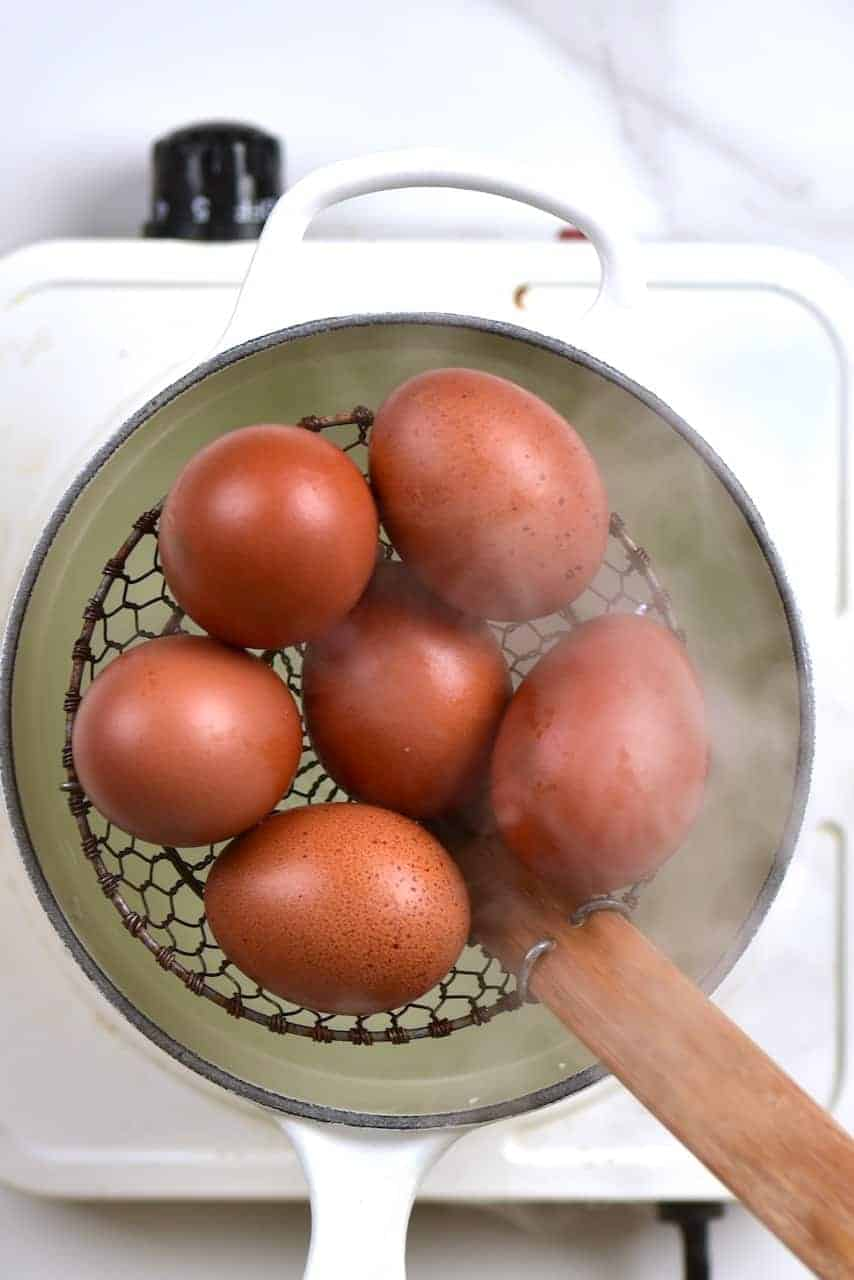 soft boiling eggs in pan of water