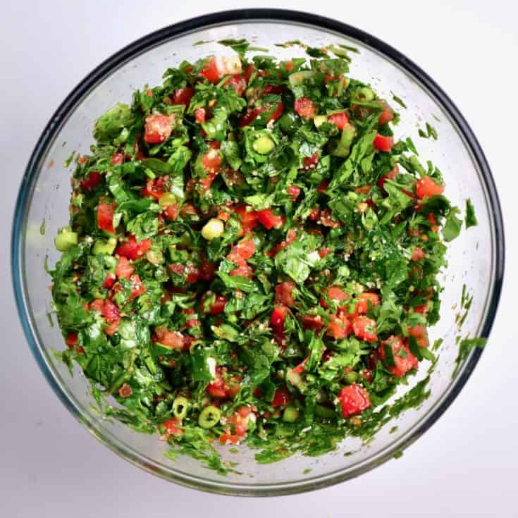 A simple Traditional Tabbouleh Salad (tabouli salad) made the way I loved eating it growing up. A delicious blend of bulgar wheat, parsley, mint and a variety of vegetables in a lemon and olive oil dressing.