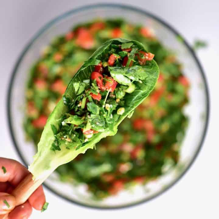 Freshly mixed Tabbouleh/tabouli salad served on a lettuce leaf