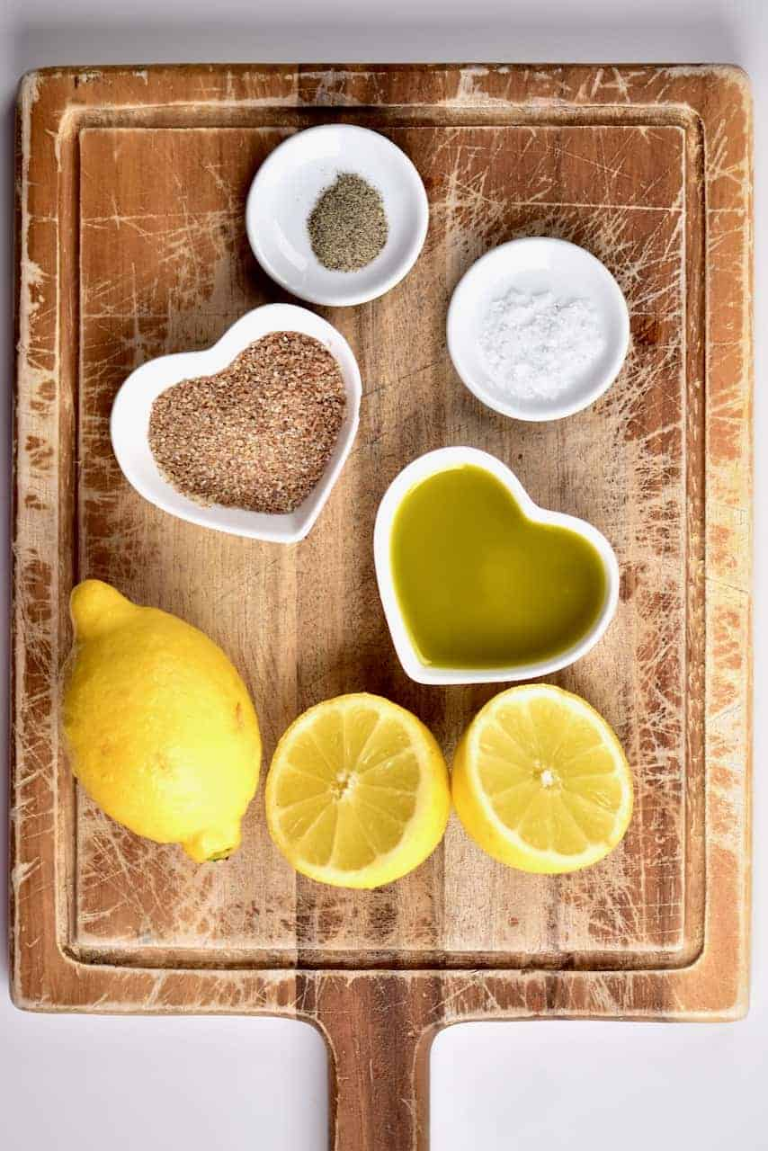 the ingredients for a lemon and olive oil salad dressing