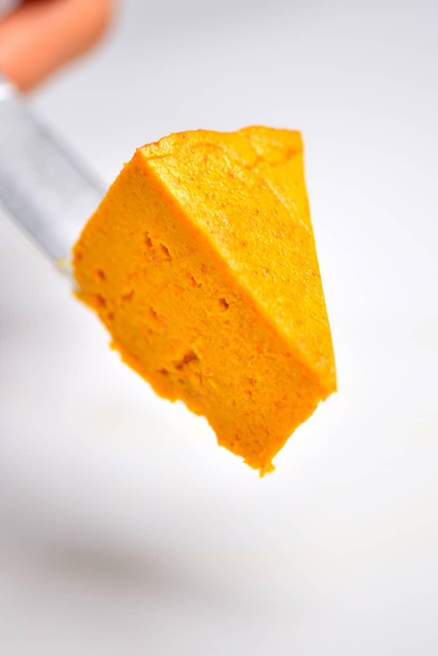 a slice of homemade vegan cheddar cheee