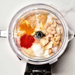 ingredients for vegan cheddar blending in a food processor