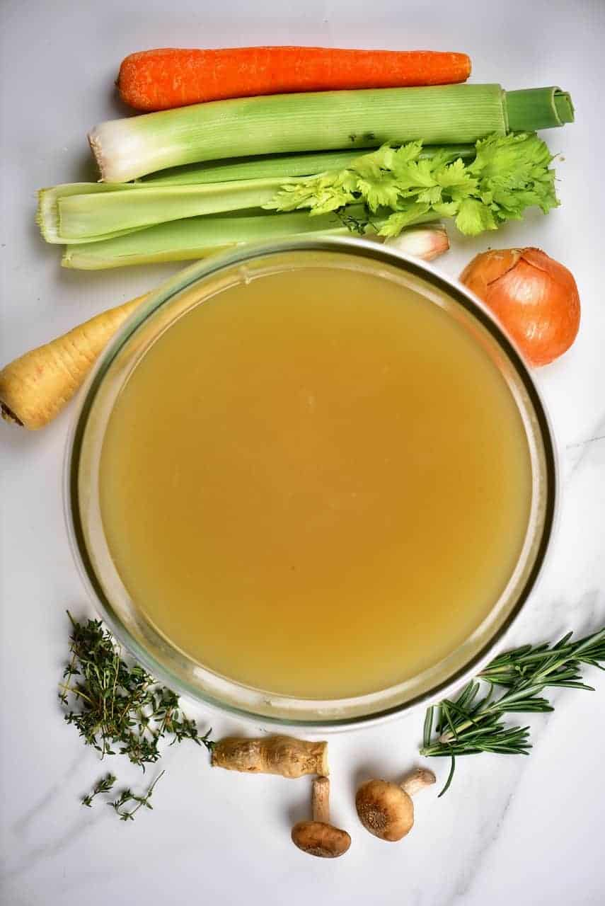 homemade vegetarian vegetable stock in a large bowl