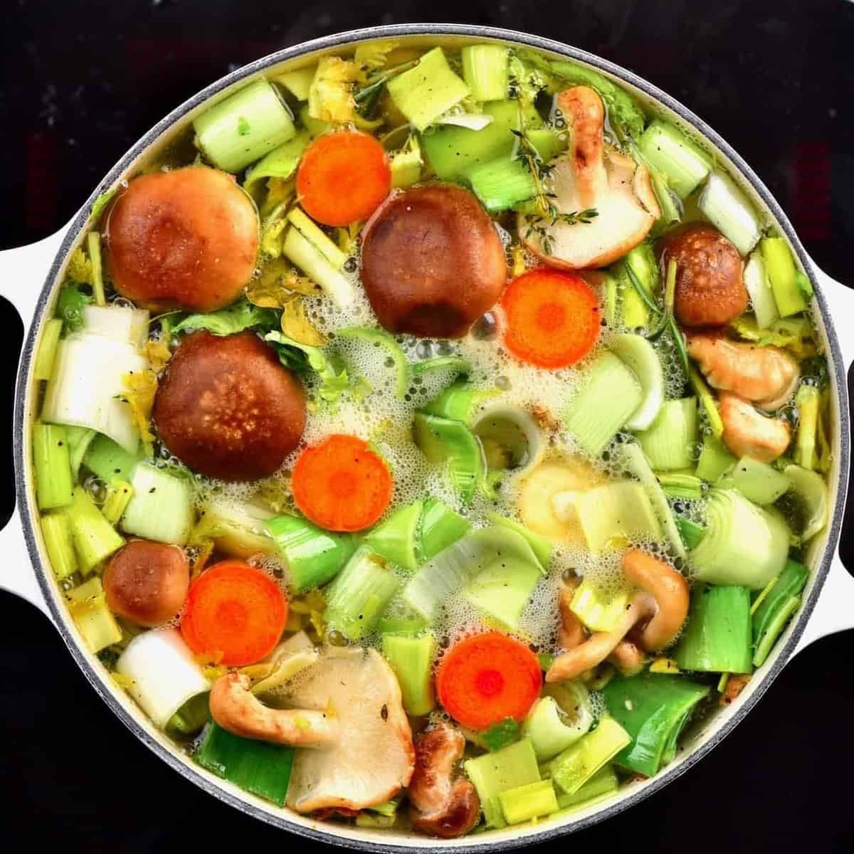 veggies in a large pan with water