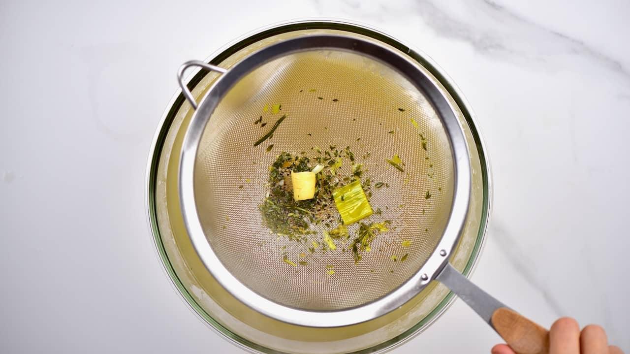 straining homemade veggie stock