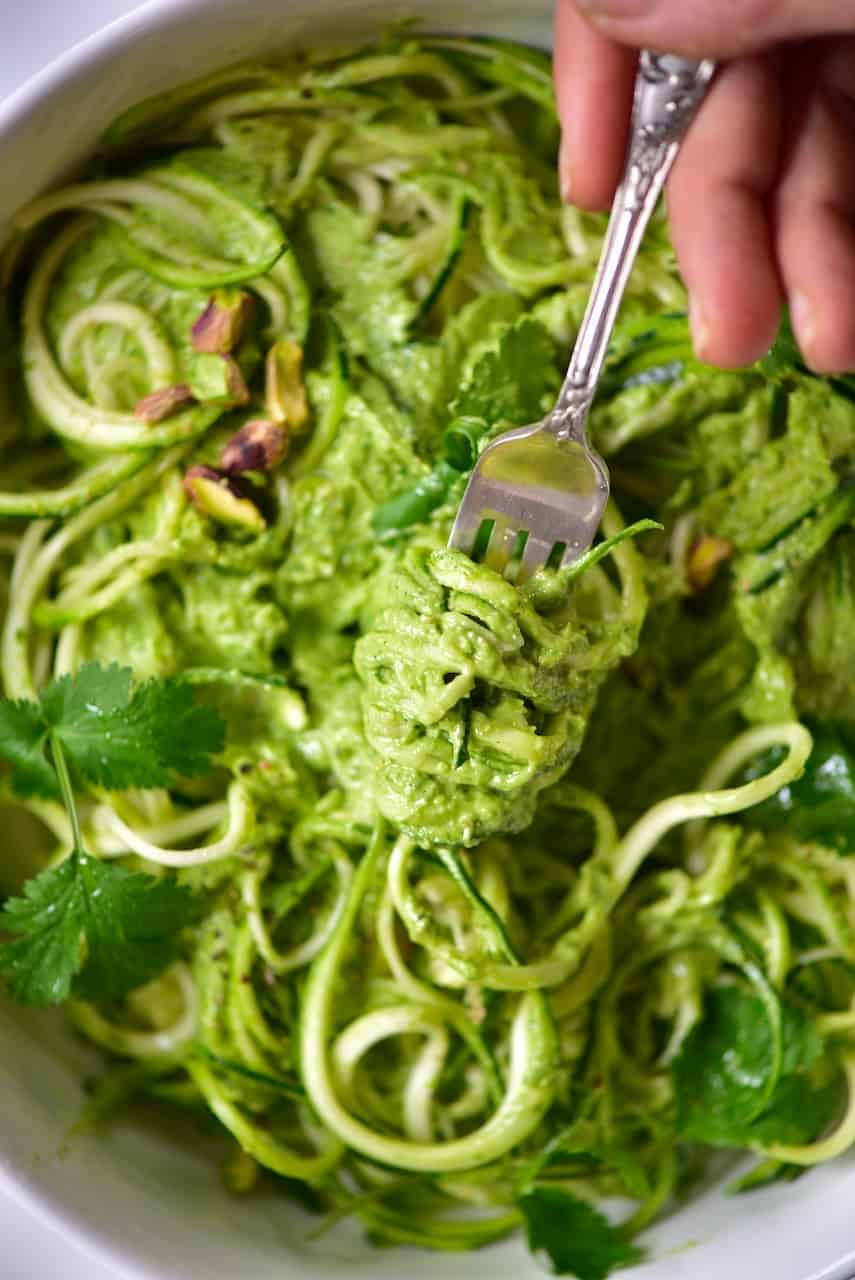 A fork with some Zoodles with Pistachio pesto