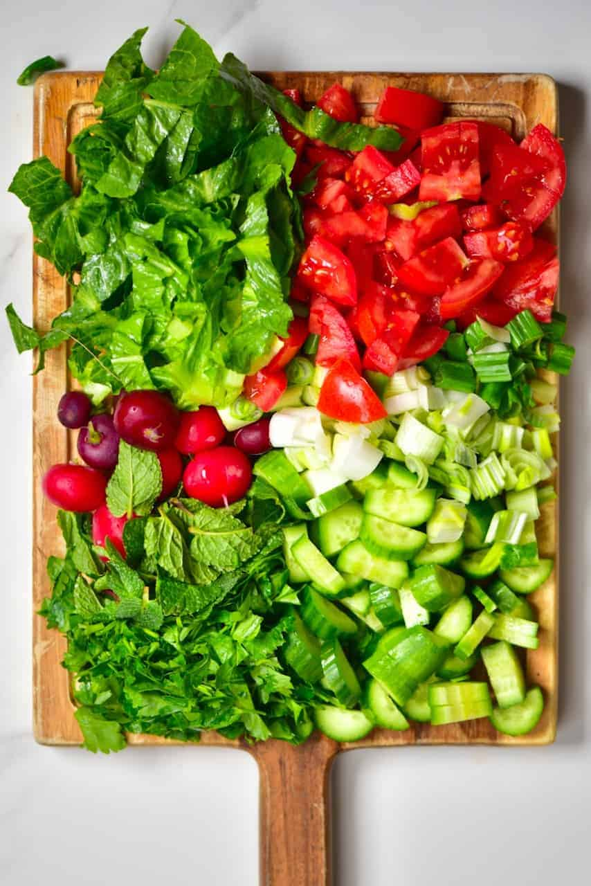 chopped up salad ingredients for a fattoush salad