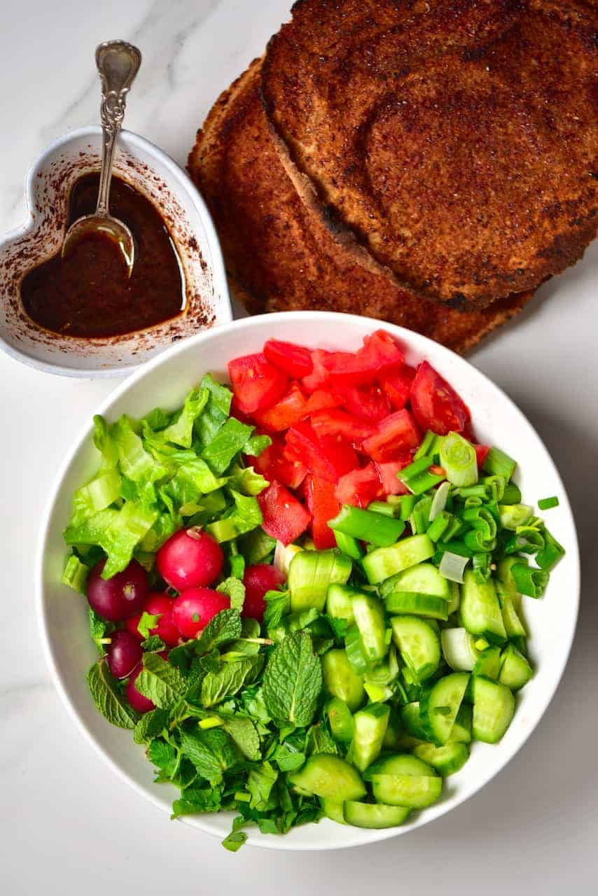 all the ingredients for A simple traditional Lebanese fattoush salad ( bread salad) with a mixture of salad vegetables, toasted pita bread and a delicious pomegranate salad dressing, for a quick, healthy meal