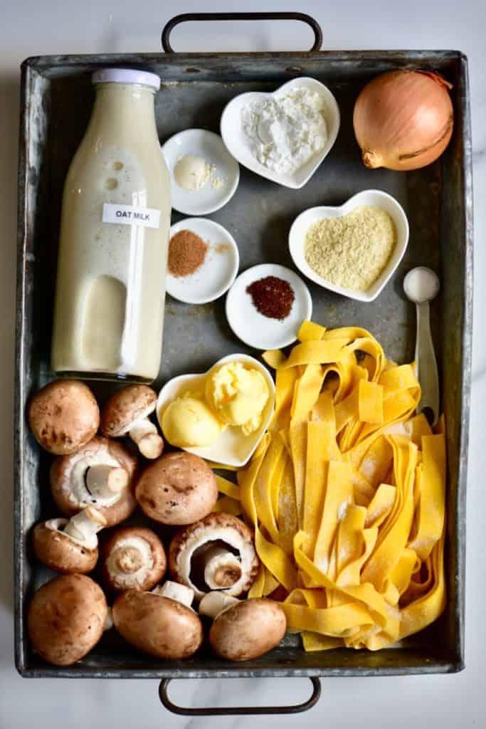 Ingredients for a creamy vegan mushroom pasta recipe