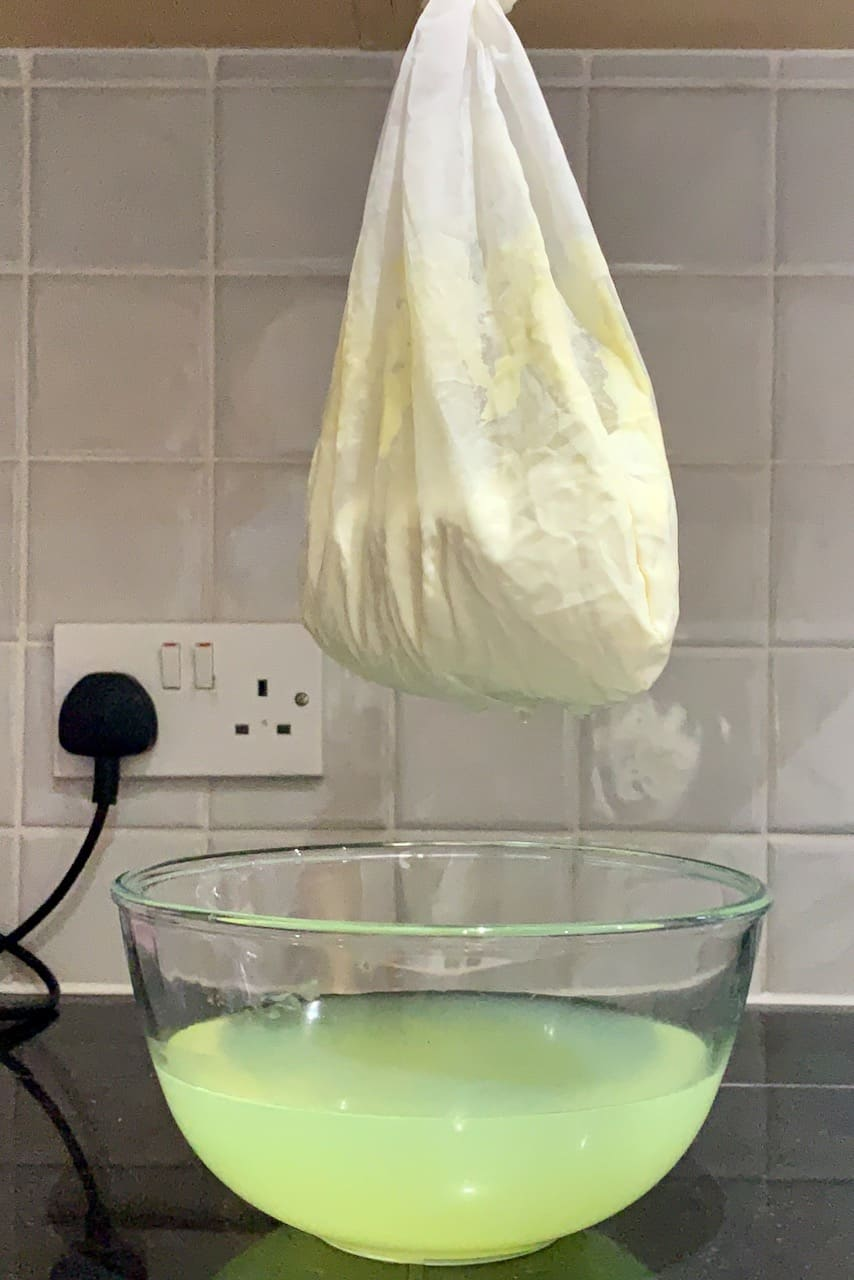 draining yogurt in a nut milk bag to make homemade labneh recipe