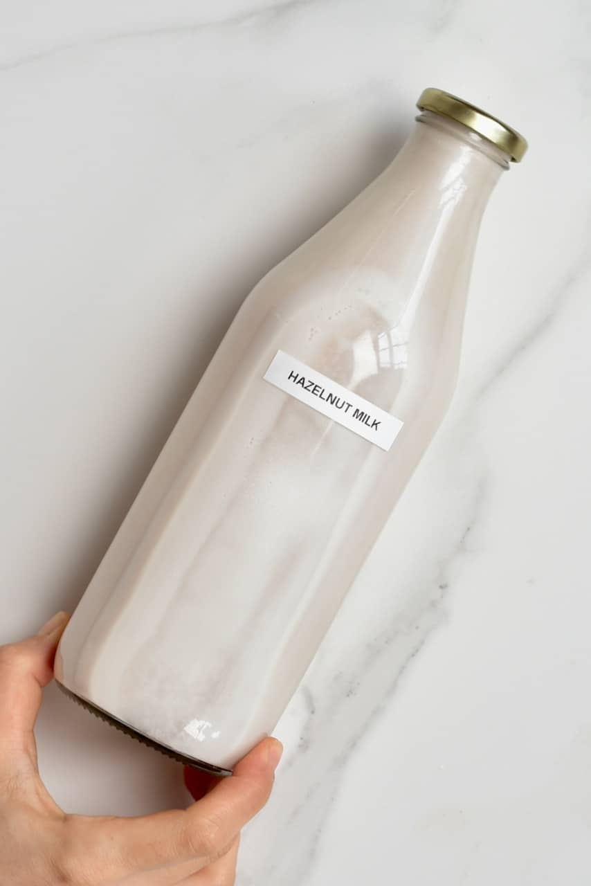 Homemade hazelnut milk in a bottle