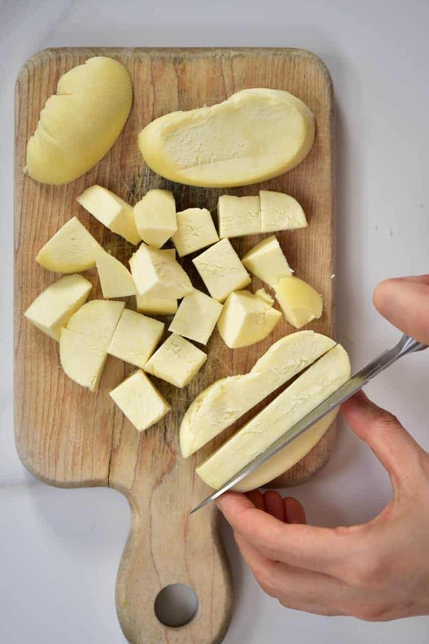 Cutting homemade paneer