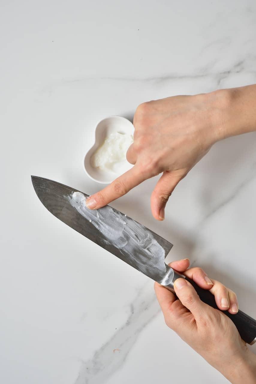 Puttin coconut oil on a knife