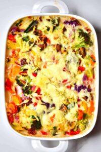 easy vegan bechamel pasta bake with rainbow vegetables.