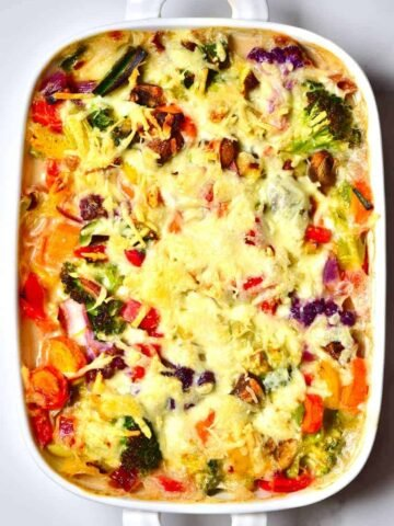 easy vegan bechamel pasta bake with rainbow vegetables.