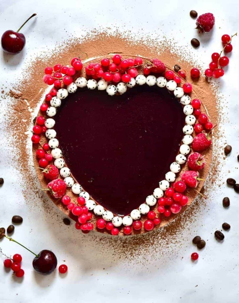 mocha red wine tart with dragonfruit pearls and red berries