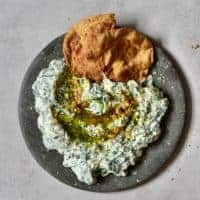 Spinach yogurt dip with pita bread