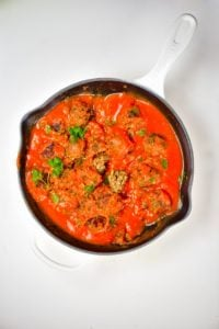 A pan with lentil meatballs with tomato sauce