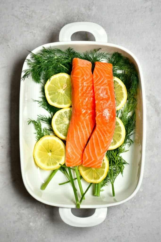 Salmon dill and lemon in a baking dish