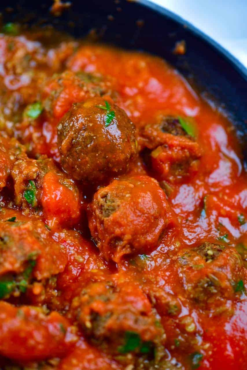 Close up of lentil meatball in tomato sauce