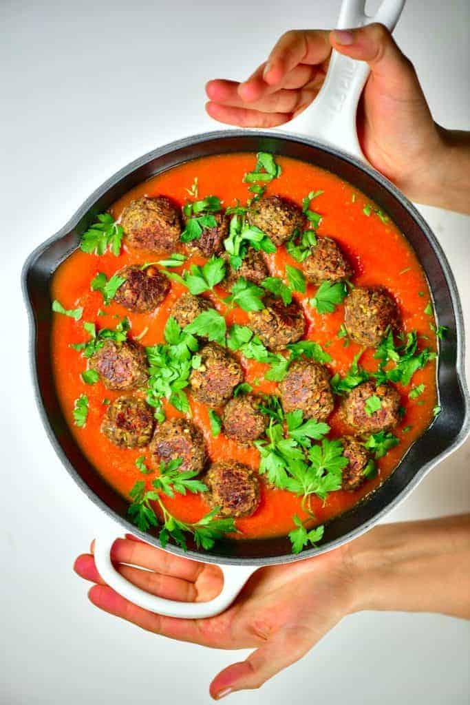 Close up of lentil meatballs with tomato sauce