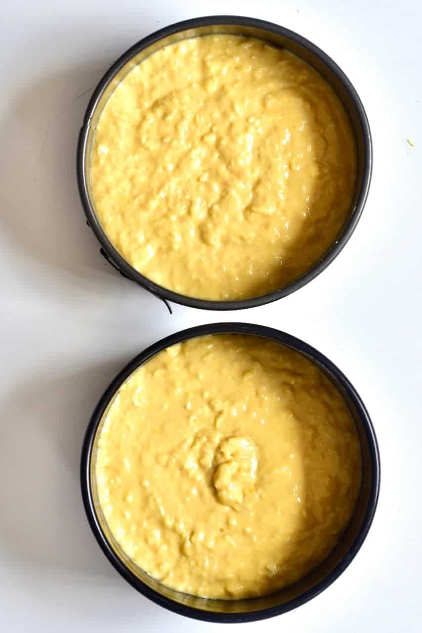 Coconut cake batter in two tins