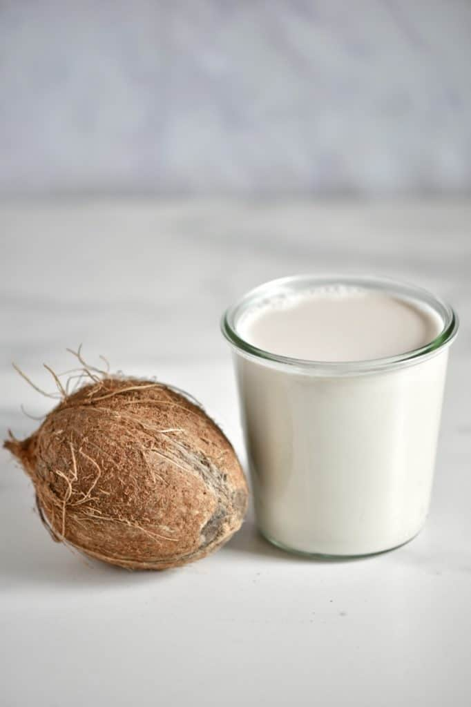 homemade Coconut cream in a jar and a coconut