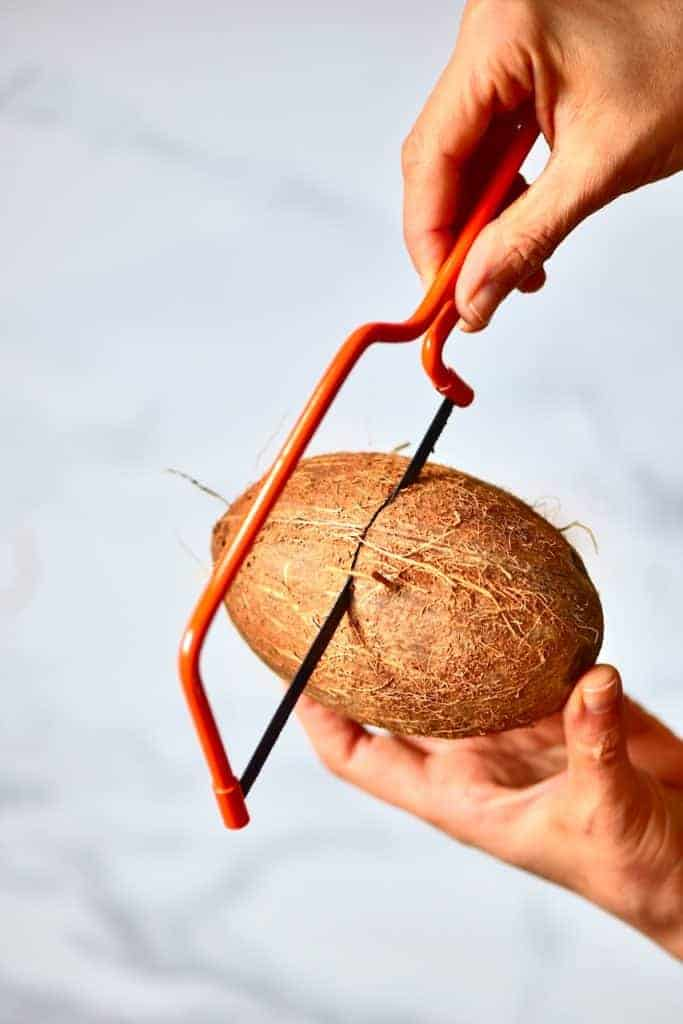 Sawing open a coconut