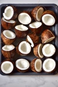 Open coconuts on a baking tray