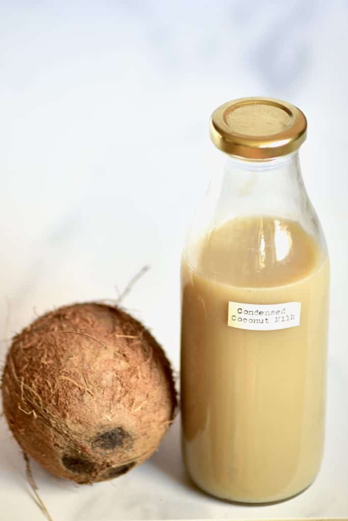 A bottle of condensed coconut milk and a coconut