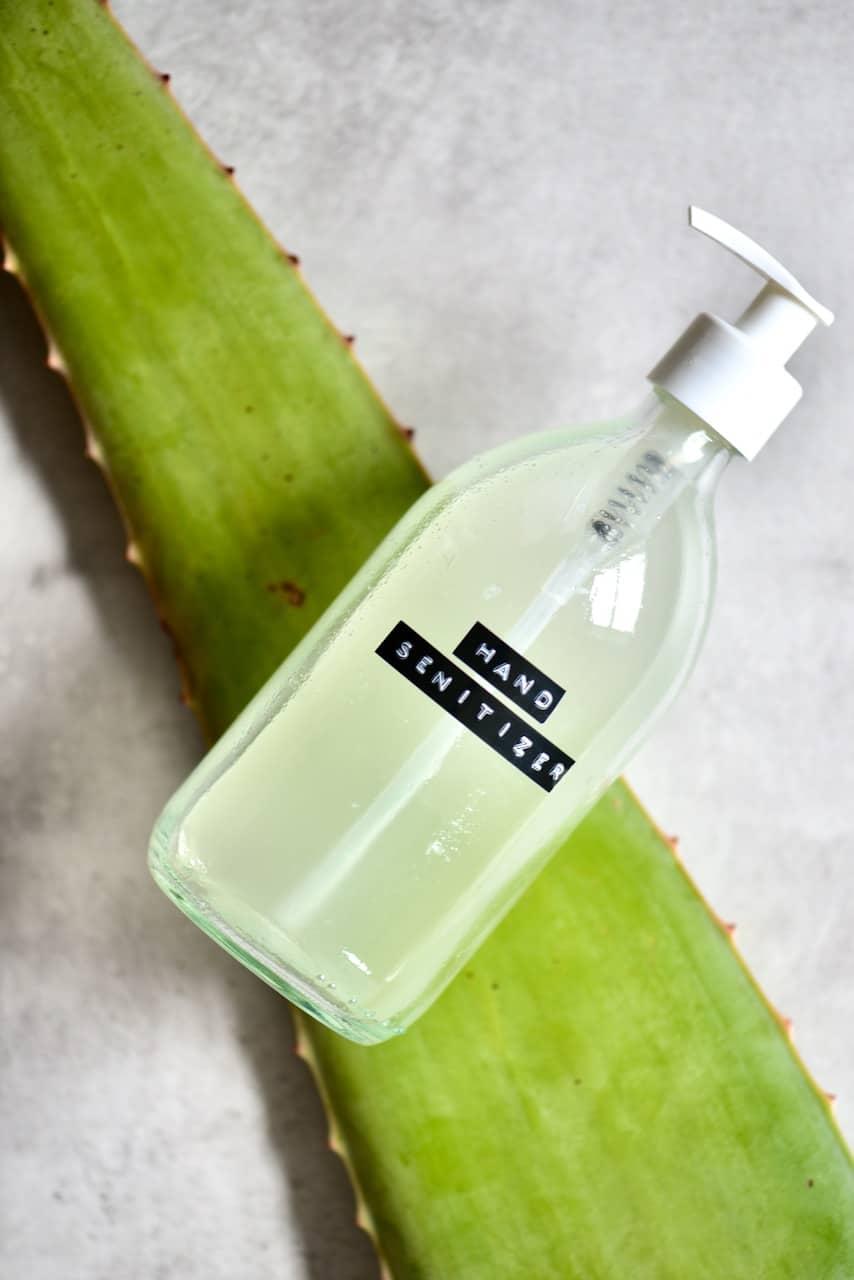 Homemade hand sanitiser over aloe vera leaf