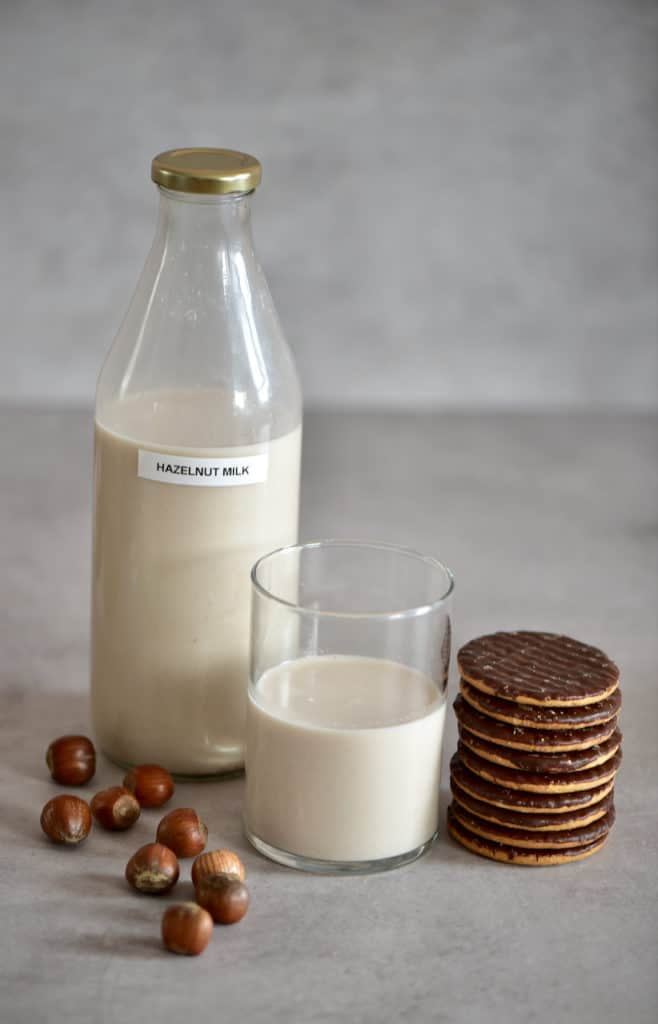 Hazelnut milk in a glass and digestive cookies