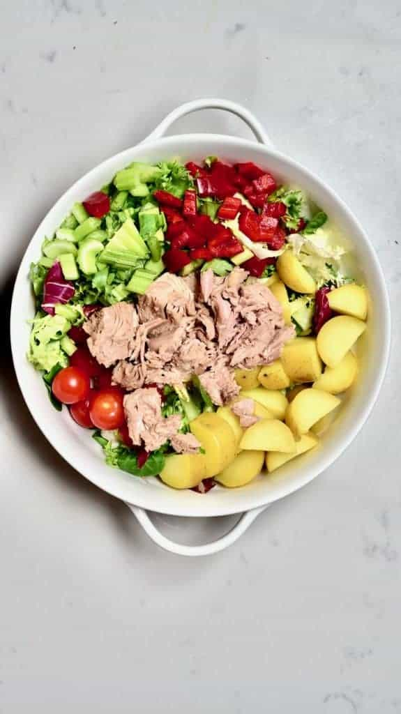 Mixing the main ingredients for Tuna Pomegranate Salad