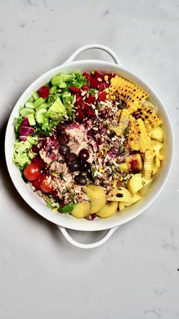 Adding spices to salad