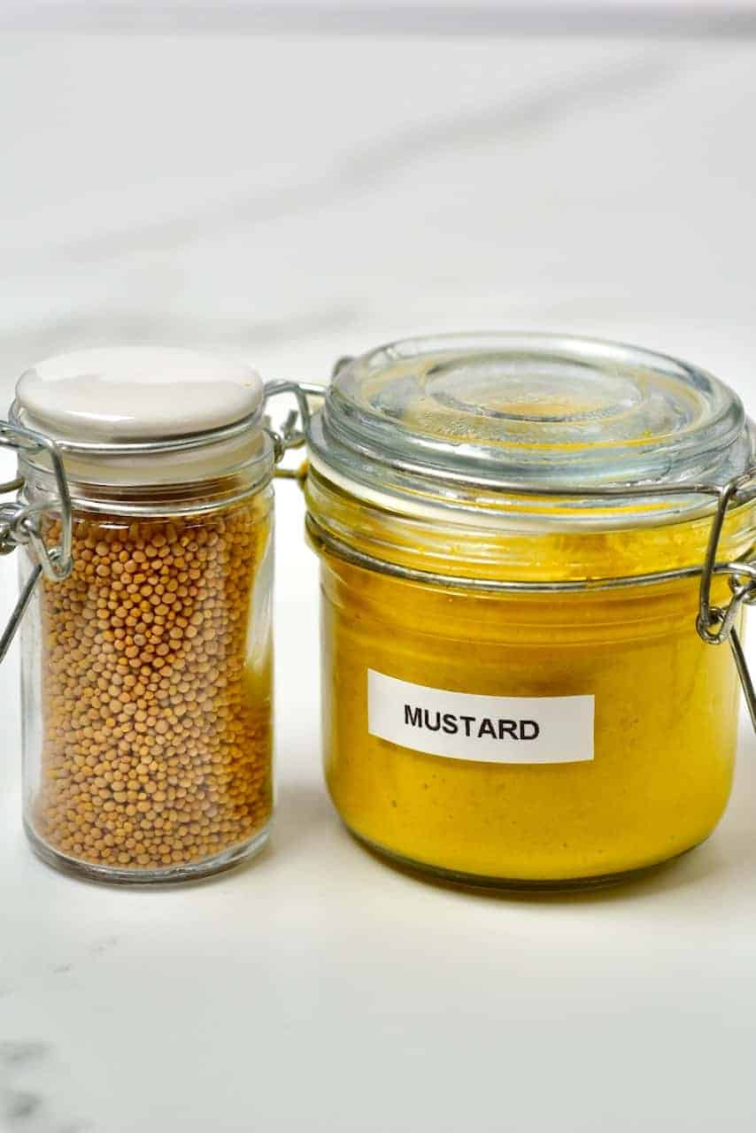 Jar of mustar and jar of seeds