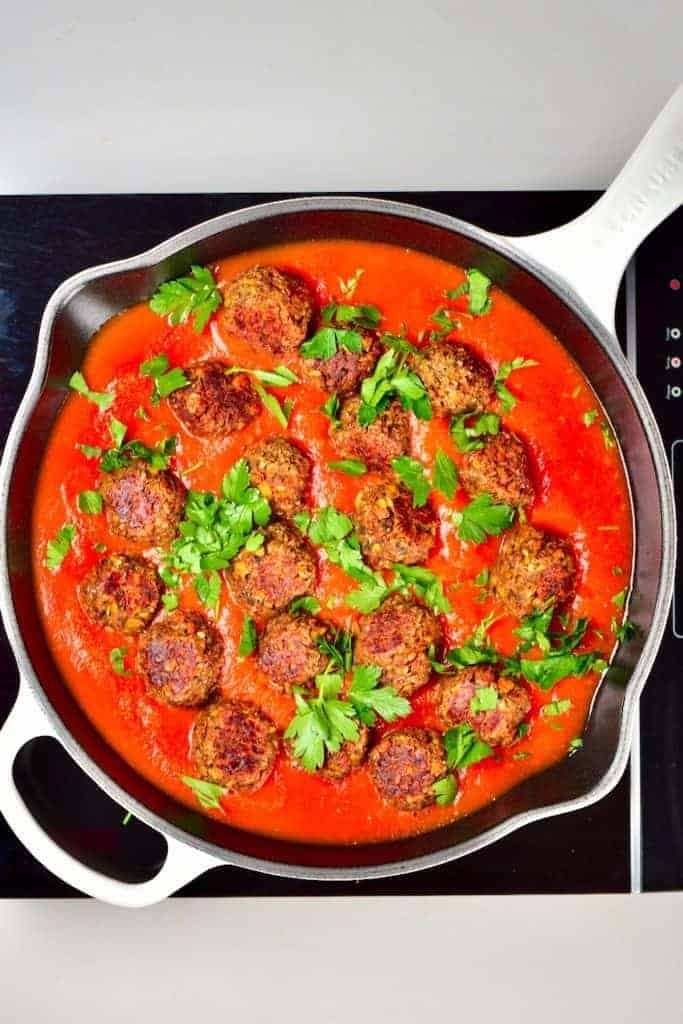 Lentil meatballs with parsley in tomato sauce