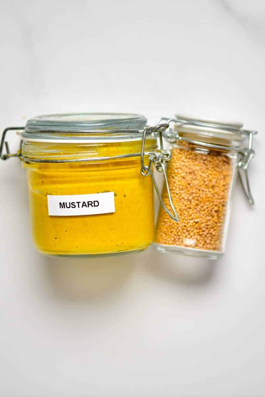 Mustard seeds and jar of mustard